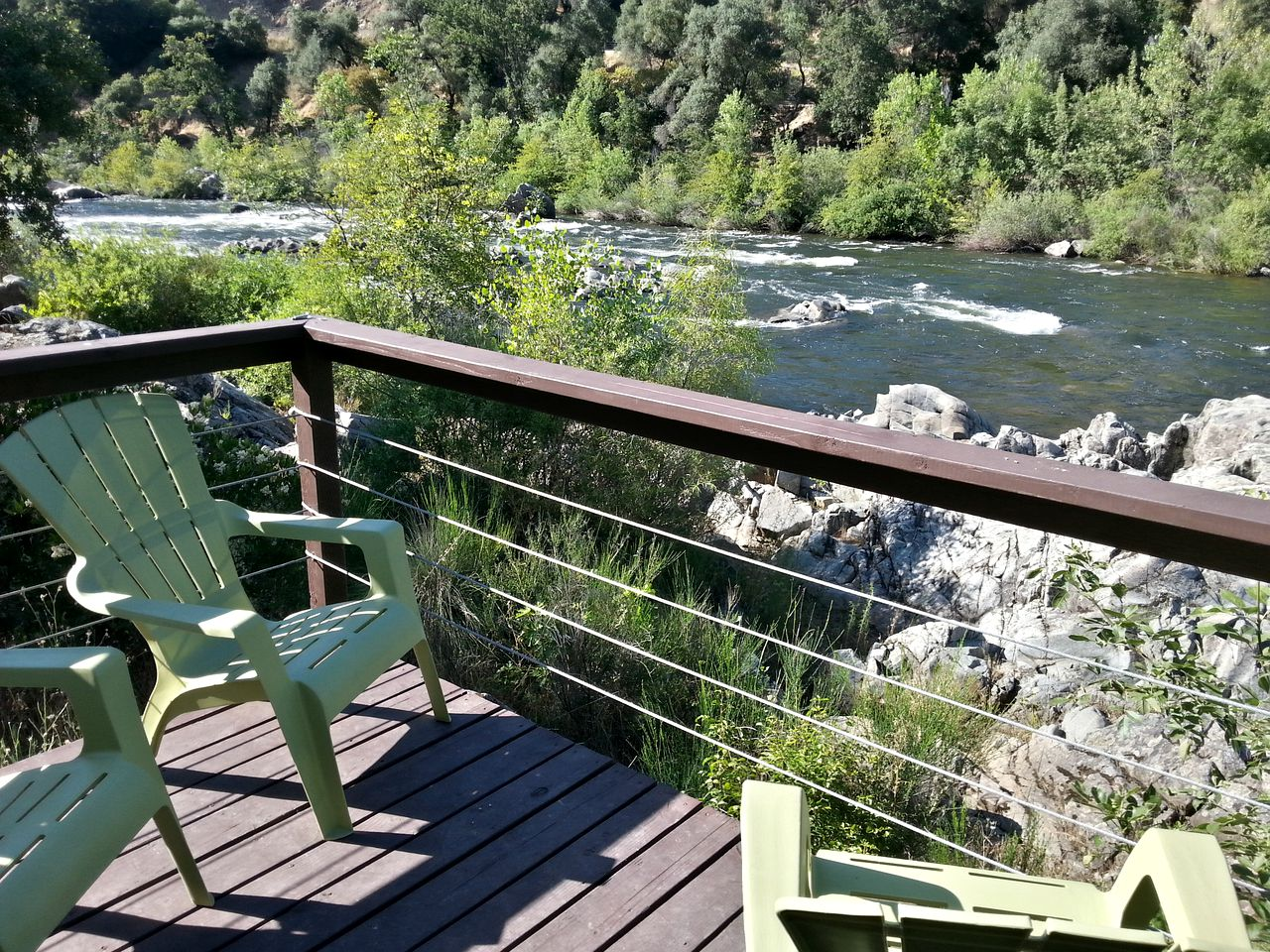 Rustic tents on the American River for glamping in California.
