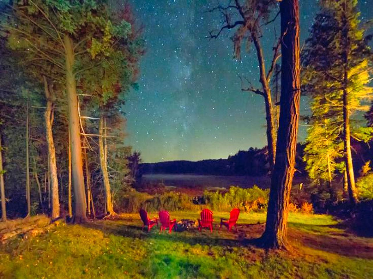 Starry night sky over a Piseco Lake, New York cabin rental.