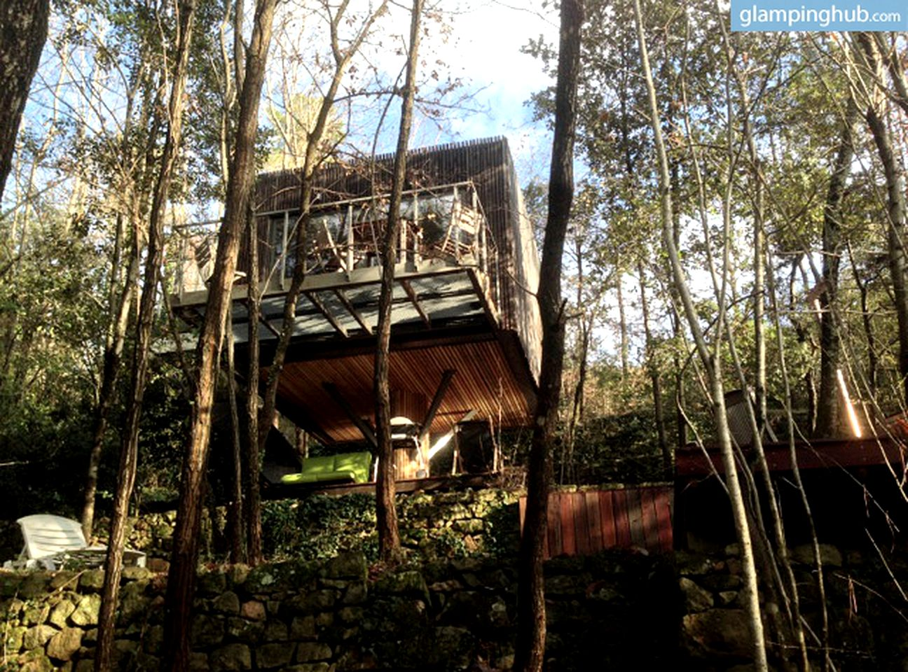 Tree house hotel with hot tub in France.