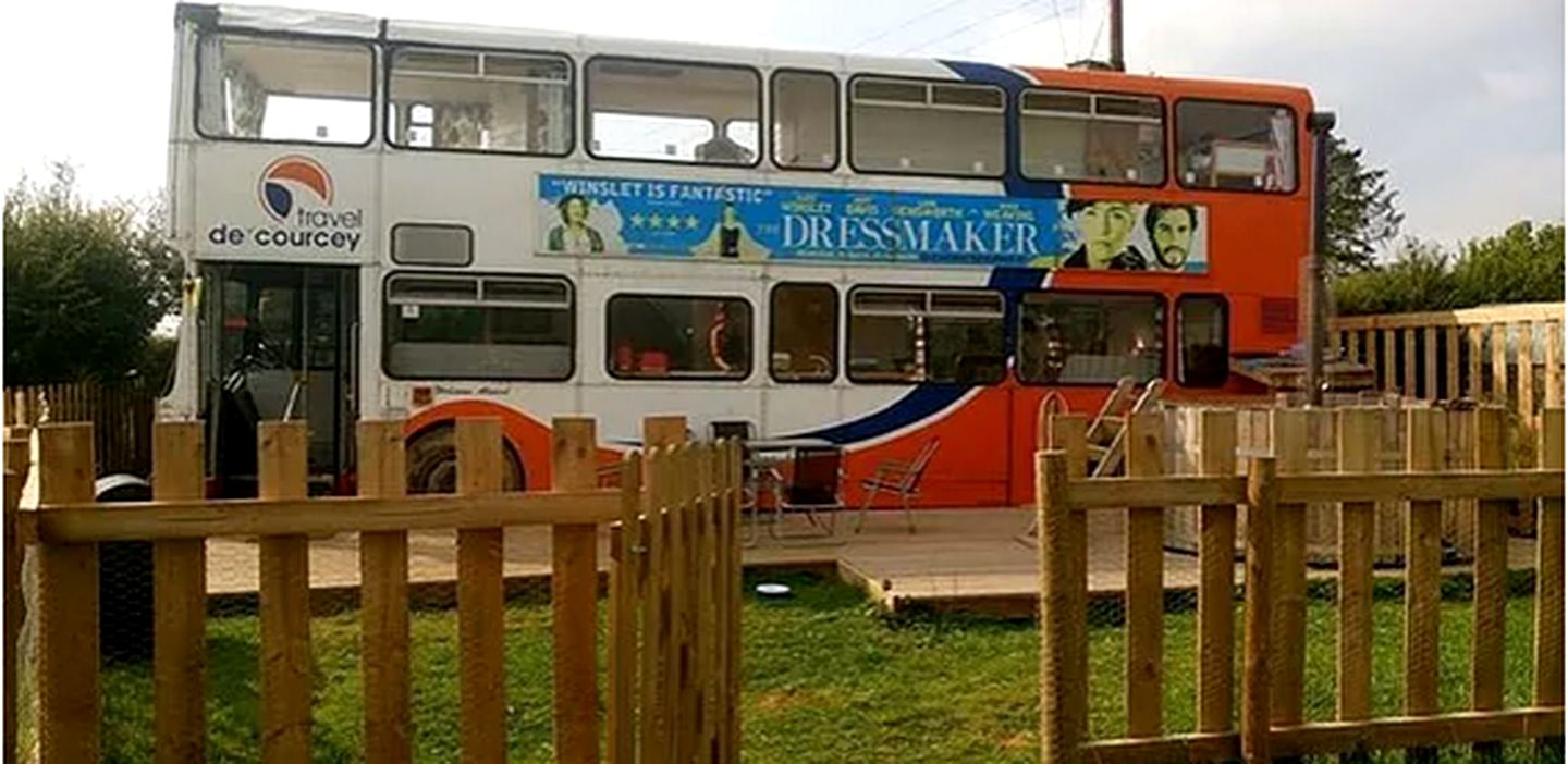 Double-decker tourist bus converted into a holiday rental in Shropshire, England.