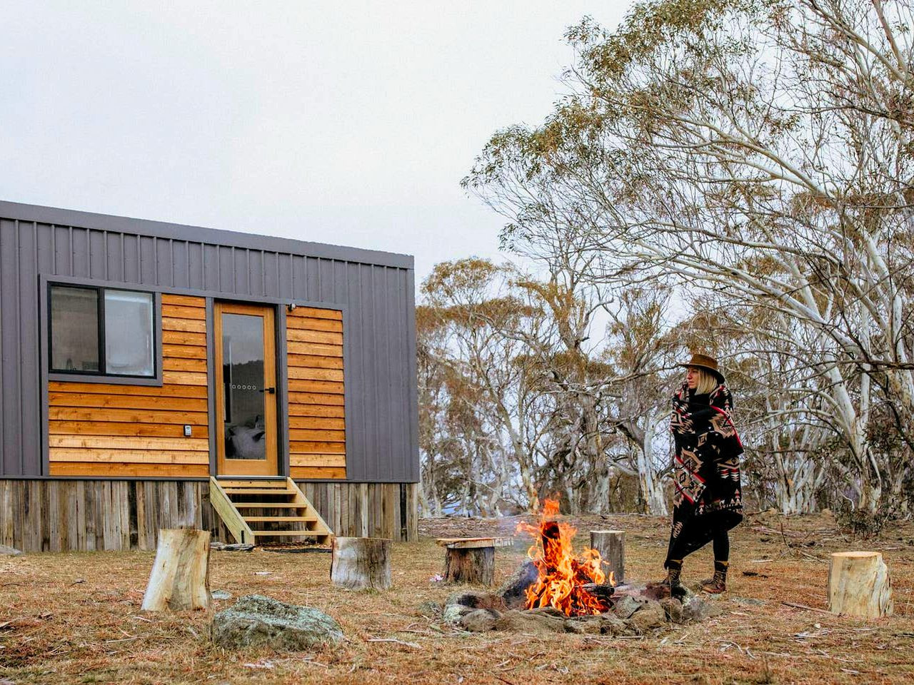 The gorgeous tiny house in New South Wales with a fire blazing merrily away in the fire pit