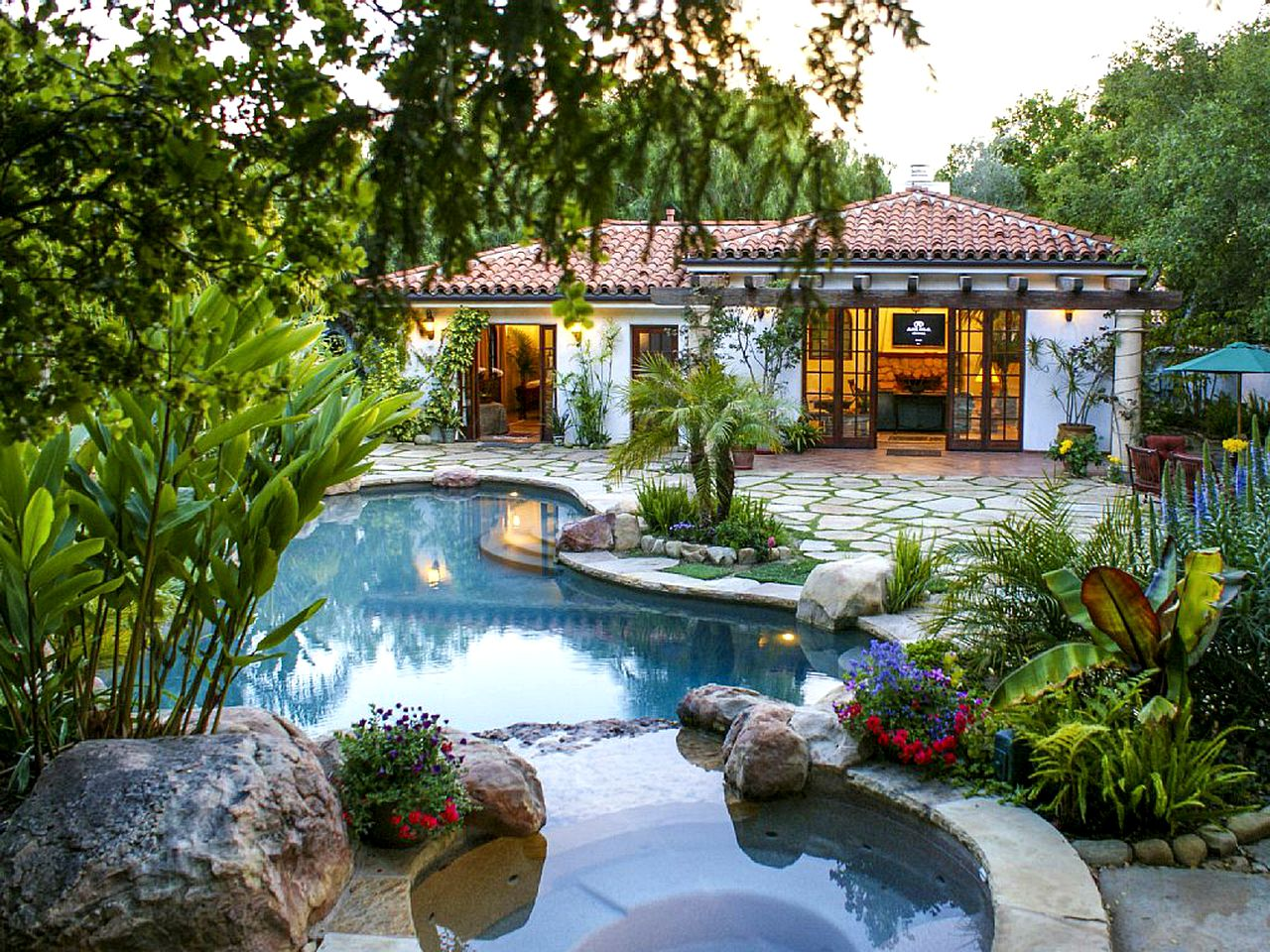 Vacation rental with a private pool and garden in the pack in Santa Barbara, California.
