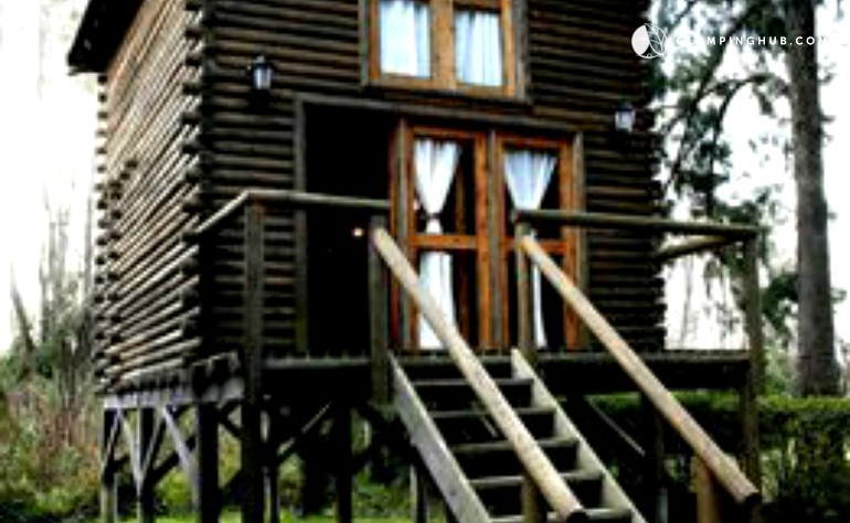 Elevated pet friendly log cabin rental for four in buenos for Elevated log cabin