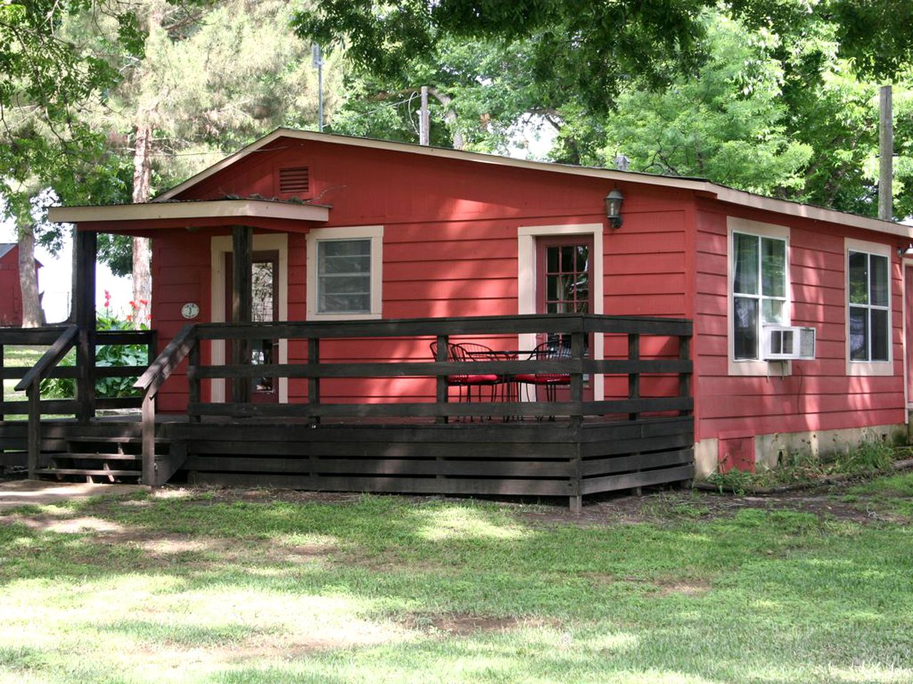 Red cabin rental on Lake Dunlap in Texas.