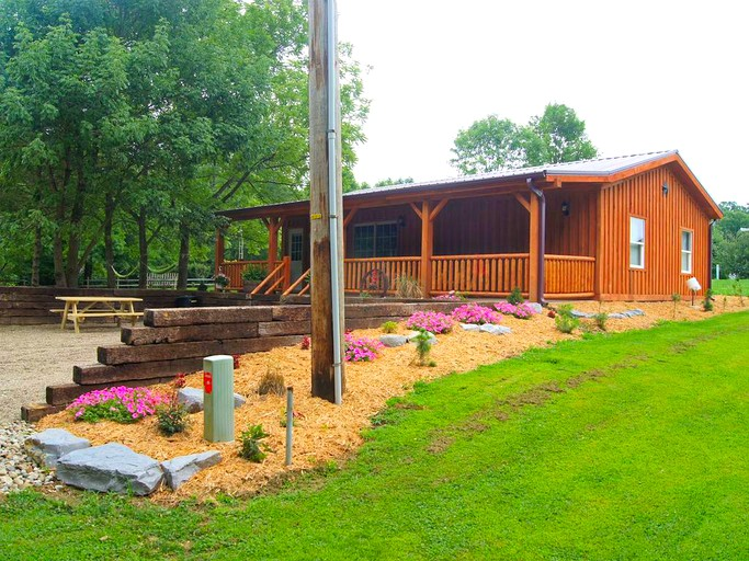 Classic Log Cabin Rental with Hot Tub Overlooking a Lake near Hoosier  National Forest, Indiana