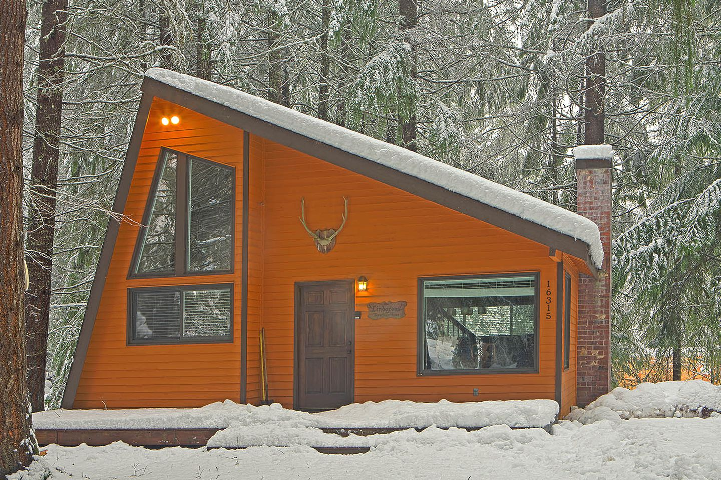 Orange exterior of one of the most unique cabins near Crystal Mountain