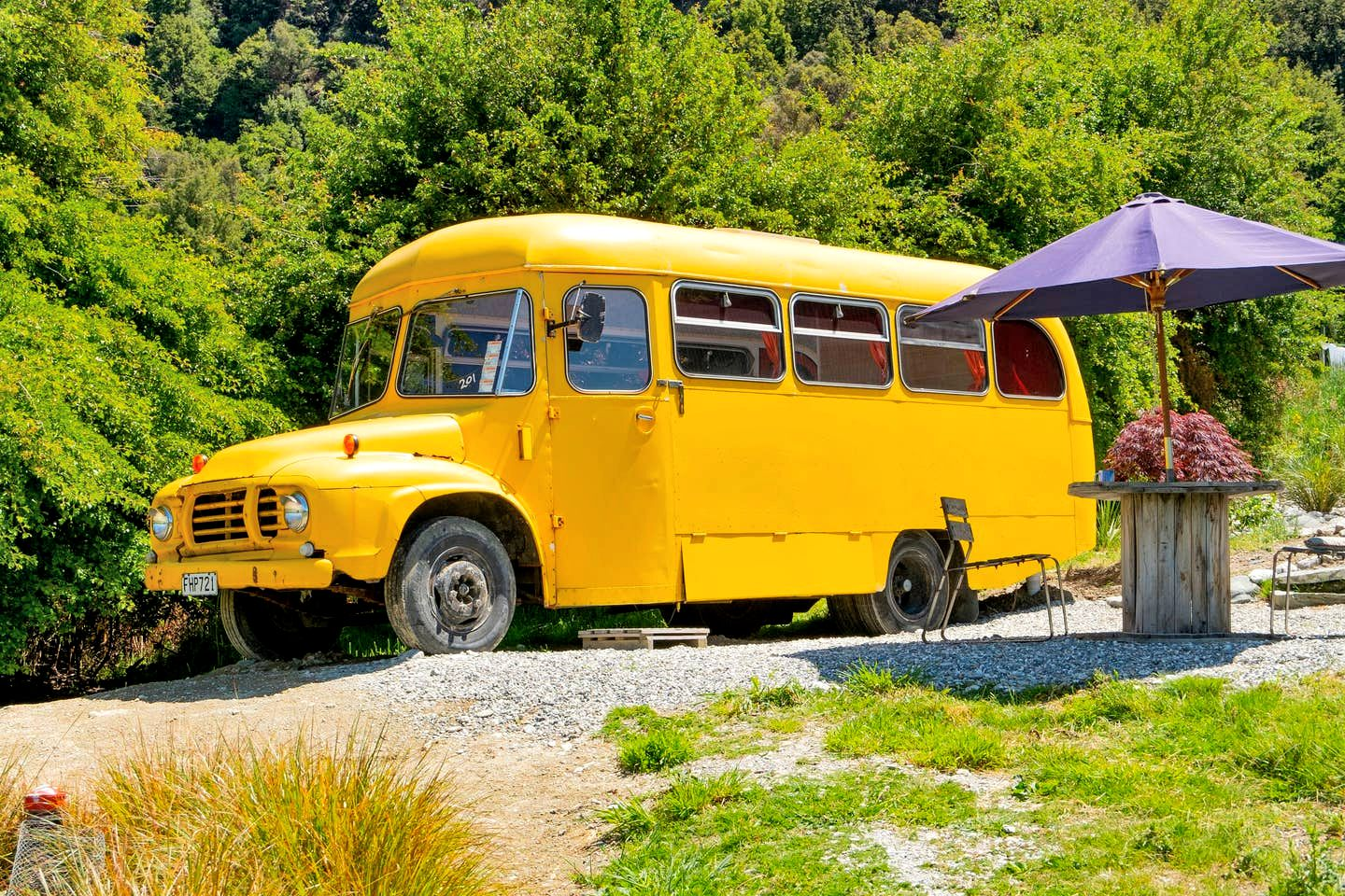 This yellow bus is perfect for guests looking to go glamping near Queenstown, South Island