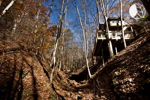 Photo of Eco-Friendly Elevated Cabin Rental for Tree House Experience near Asheville