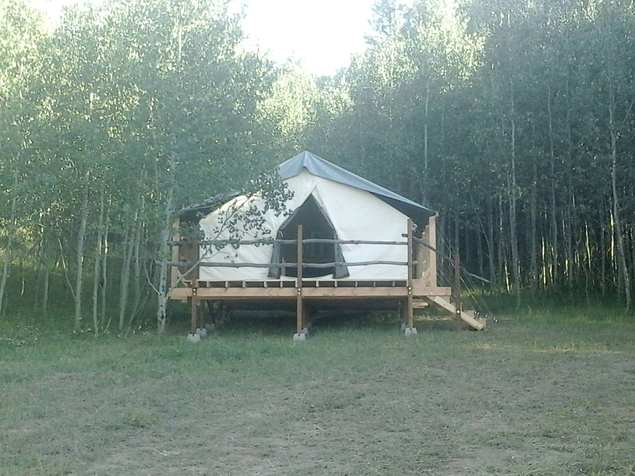 Elevated safari tent rental for a vacation in Idaho Falls.