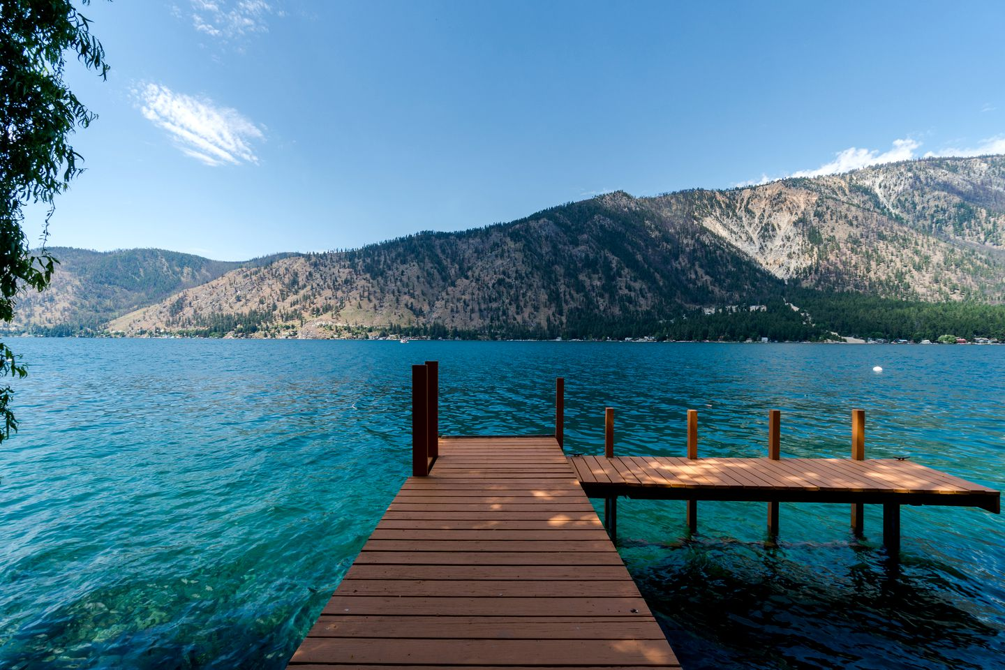 The water shines irresistible shades of blue at Lake Chelan. Boat rentals, lakeside walks and lazy days on the pier await