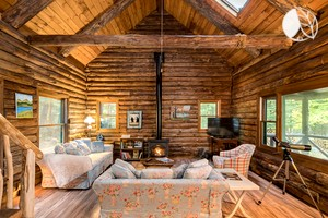 Photo of Lakefront Log Cabin Rental Set in Forestry of Adirondack Park, New York