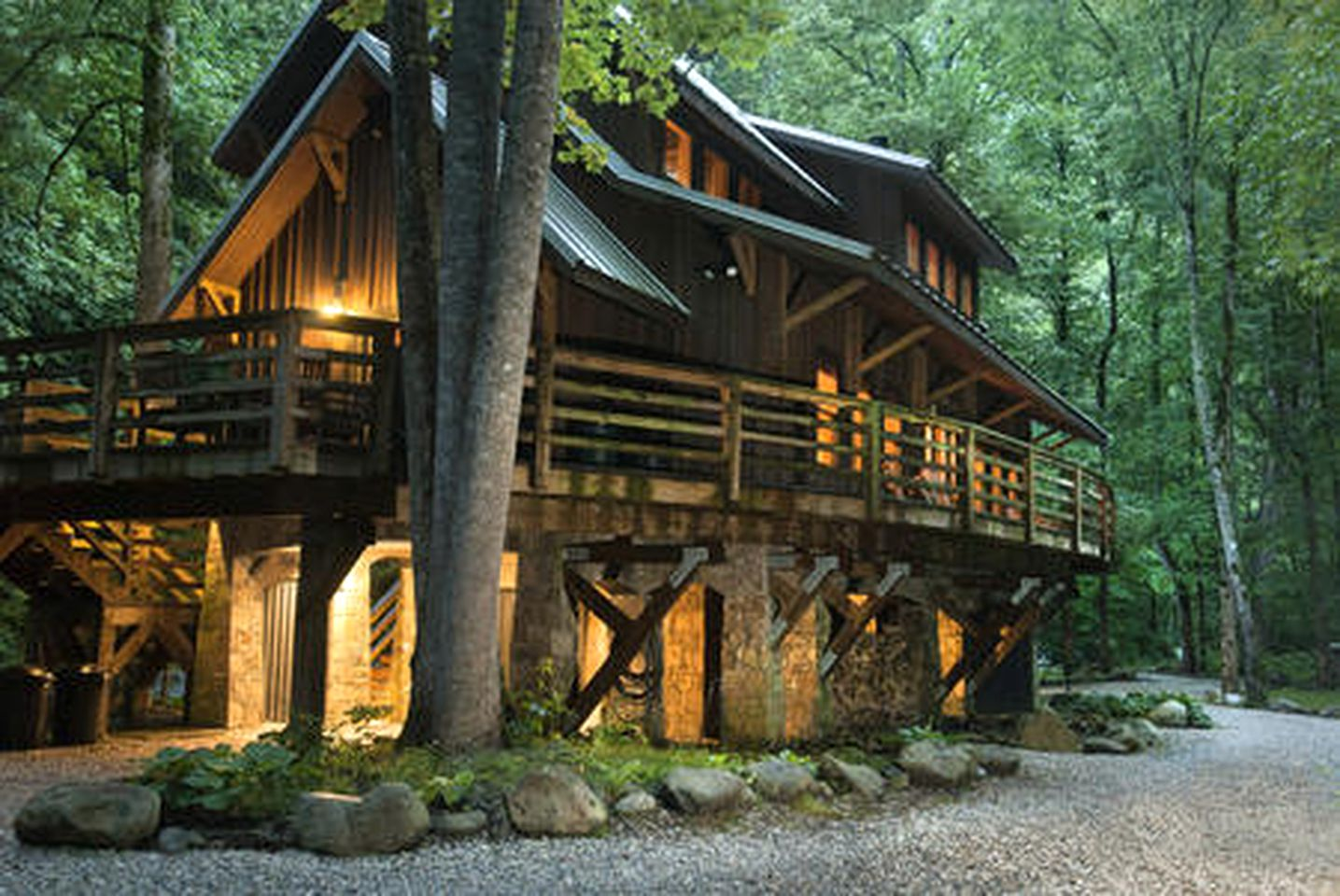 Lights on at dusk in North Carolina River cabin rentals | Luxury rivercabin