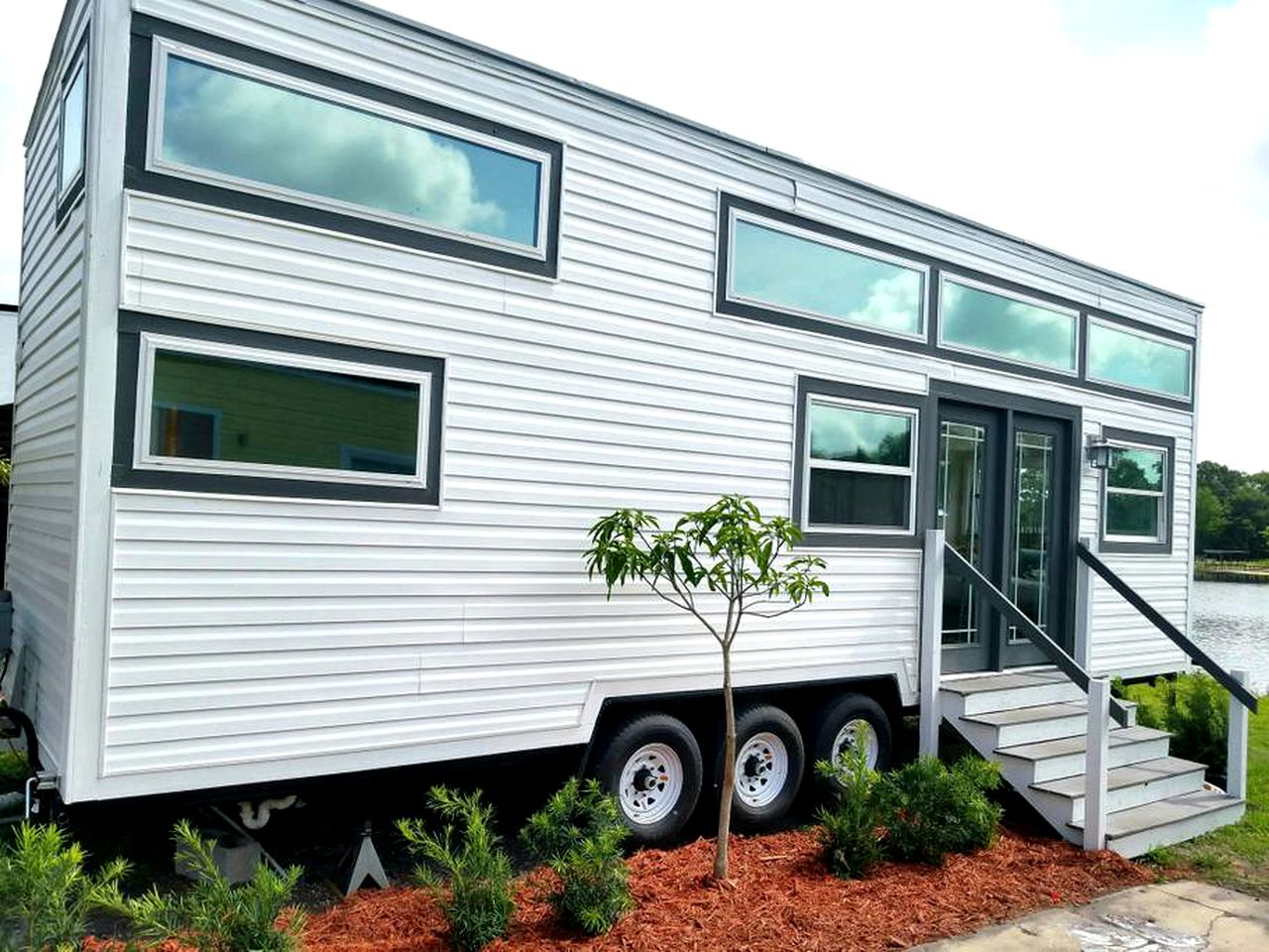 White, paneled tiny house rental for a glamping vacation in Orlando, FL.