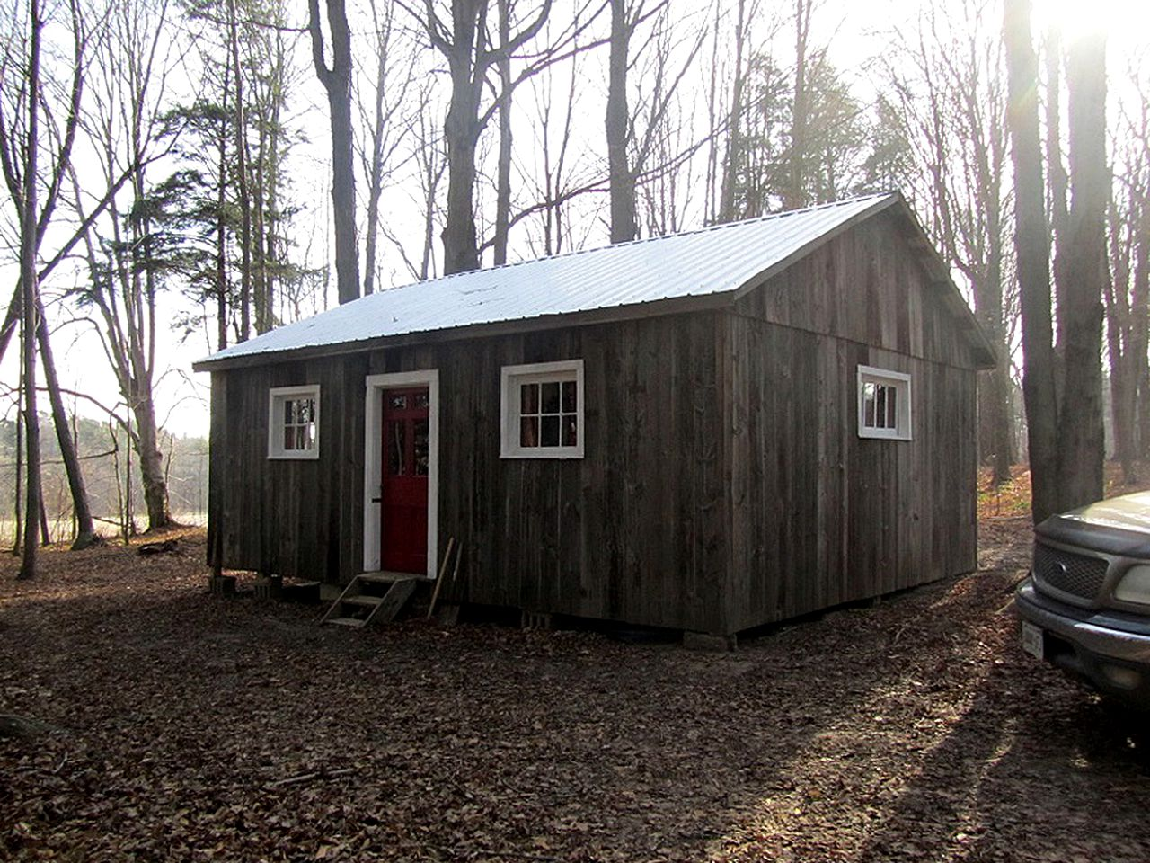 Pet-friendly cabin rental surrounded by trees, near Otter River, in Ontario.