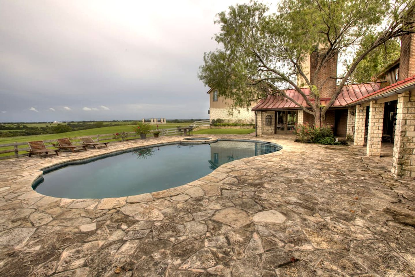 Luxury villa rental with private pool and stone patio on a ranch near Austin, TX.