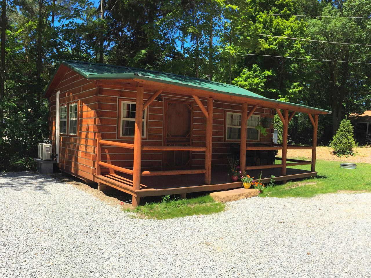 Pet-friendly cabin rental surrounded by trees in Harbor Country, Michigan.