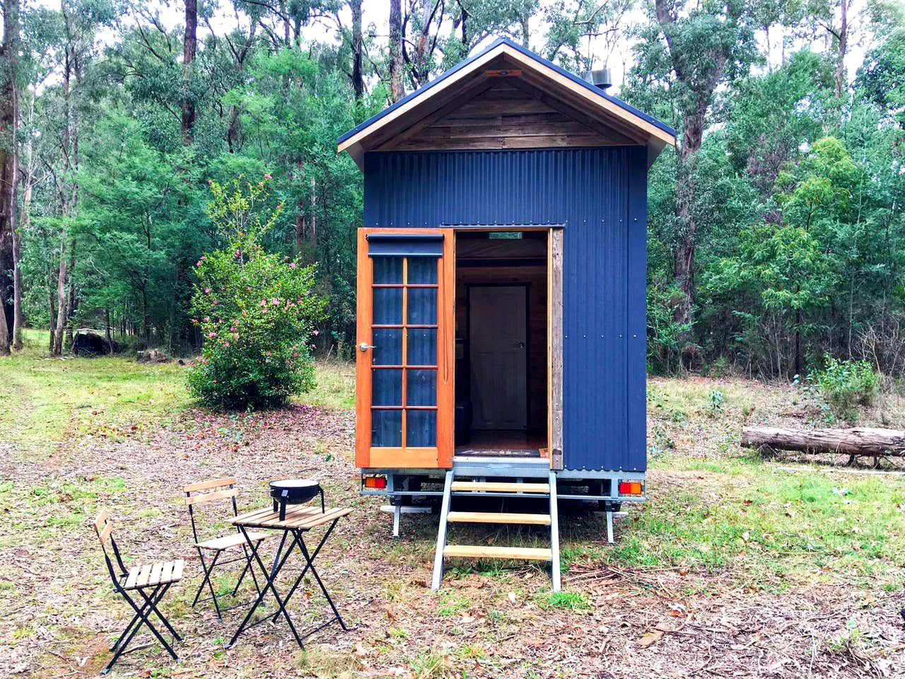 Unique tiny house with wood-clad interior for best glamping in Victoria.