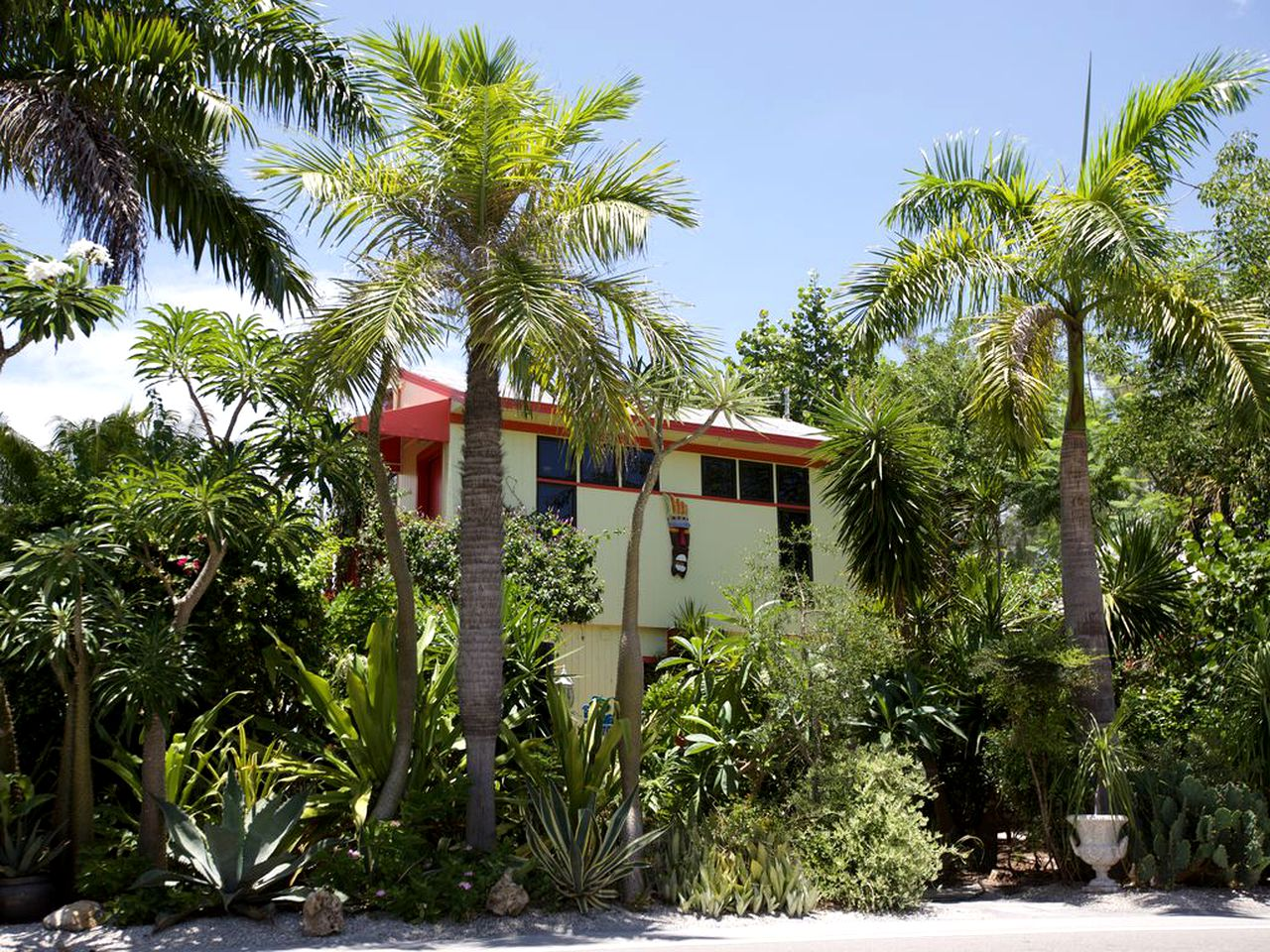 Vacation rental surrounded by palm trees on Captiva Island, Florida.