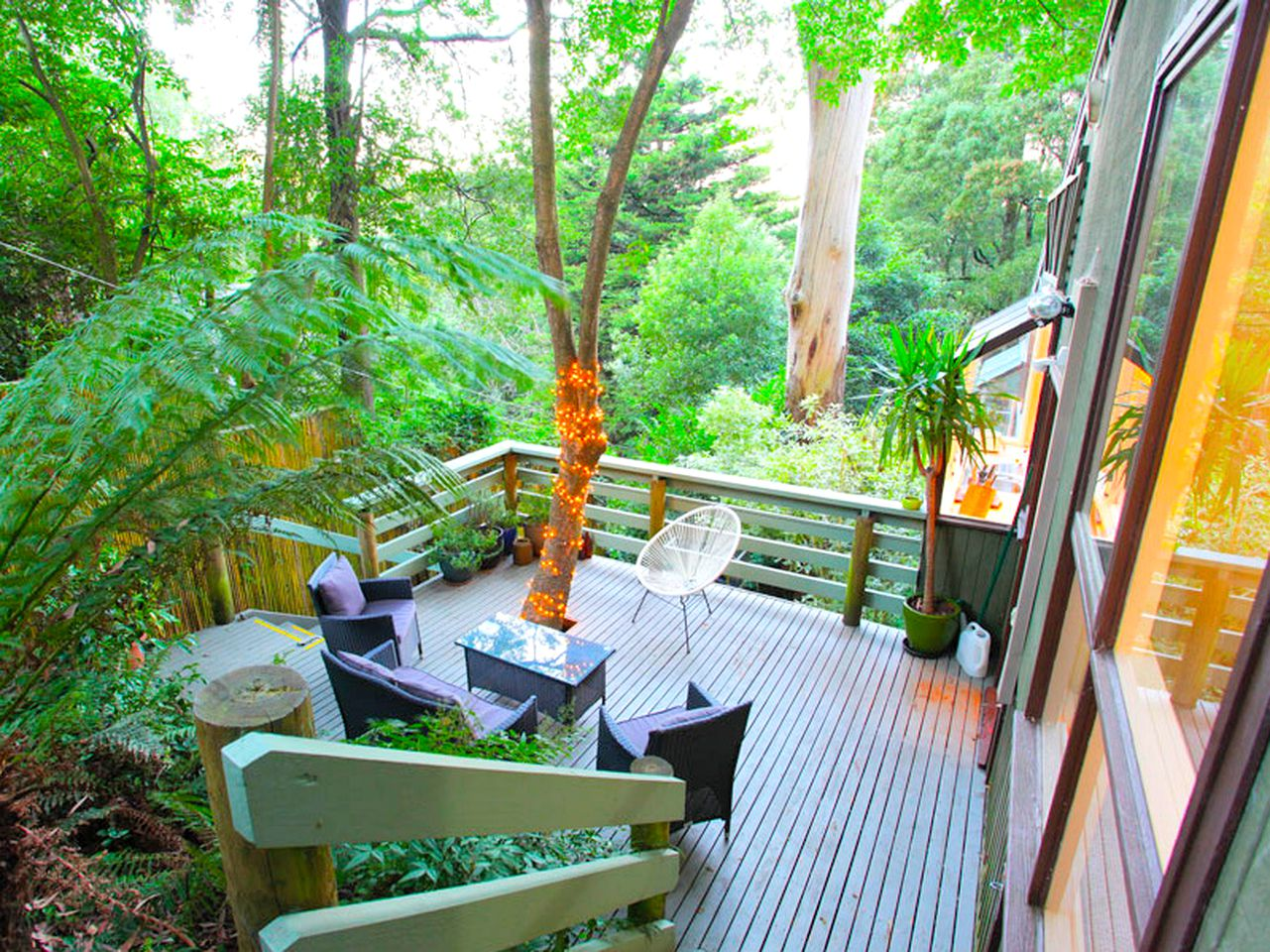 The gorgeous deck set among the tree canopy. This Sassafras accommodation is perfect for tree house glamping in Victoria.
