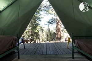 Photo of Stunning Tent Cabins near Shoreline of Lake in High Sierra