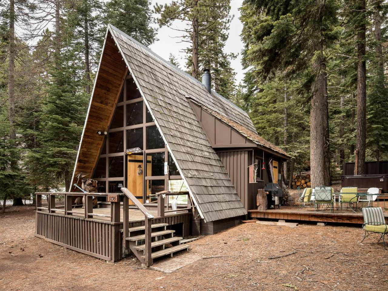 A-frame cabin in California and Lake Tahoe vacation rental surrounded by trees.