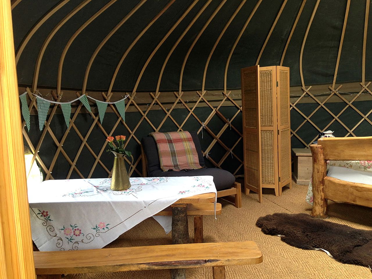 Inside of a yurt camping rental in the countryside of Surrey, England.