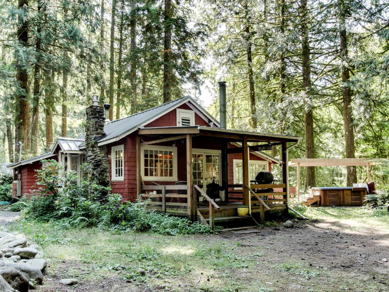 Private cabin rental surrounded by trees in forest clearing near Mount Hood, Oregon.
