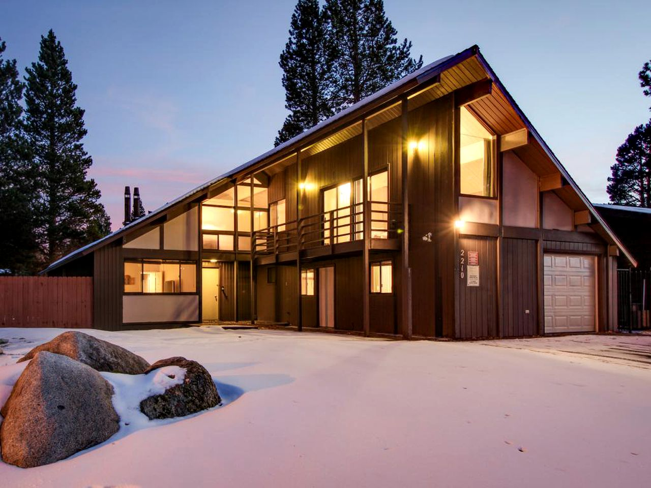 Driveway and entry to large, modern cabin on the water in South Lake Tahoe, California